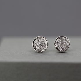 Pave set Diamond stud Earrings with spare Diamonds
